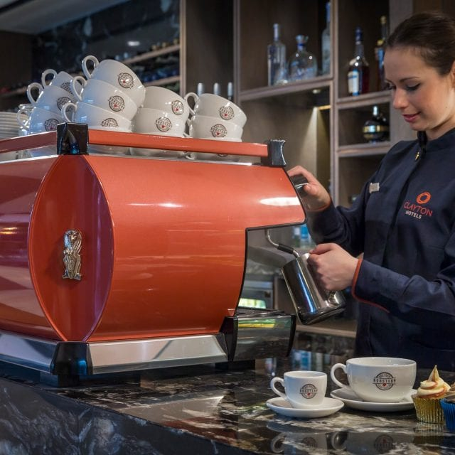 A Barista steaming milk at the Clayton Hotel Belfast